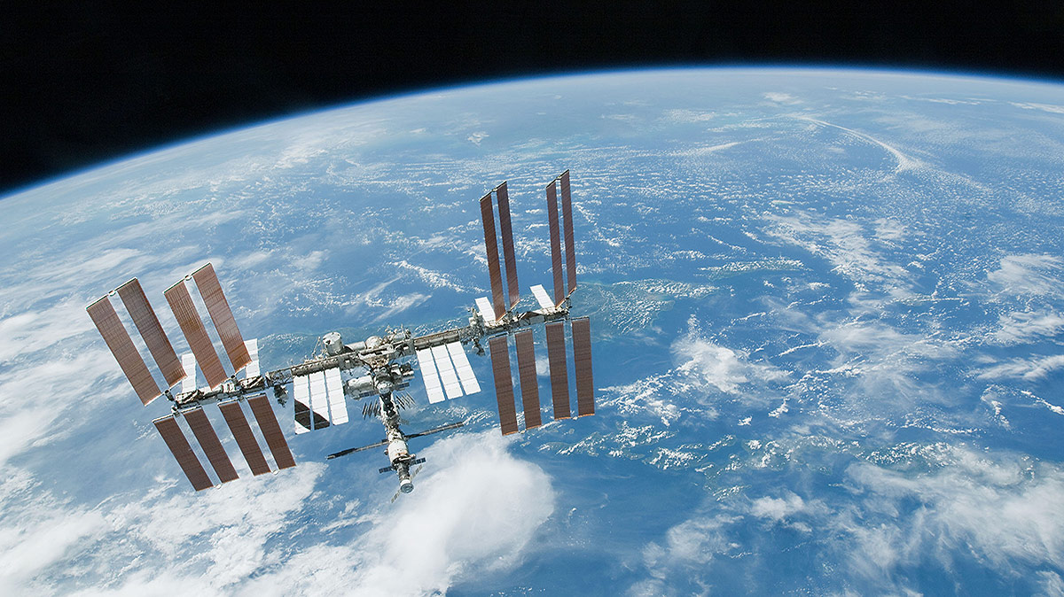 station over blue white earth